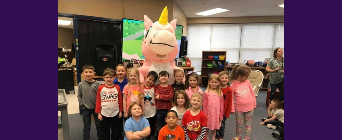 Students standing with unicorn